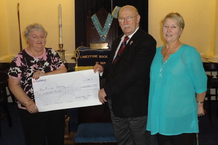 Limestone Rock Lodge No 369 Present cheque to Macmillan Nurses and others