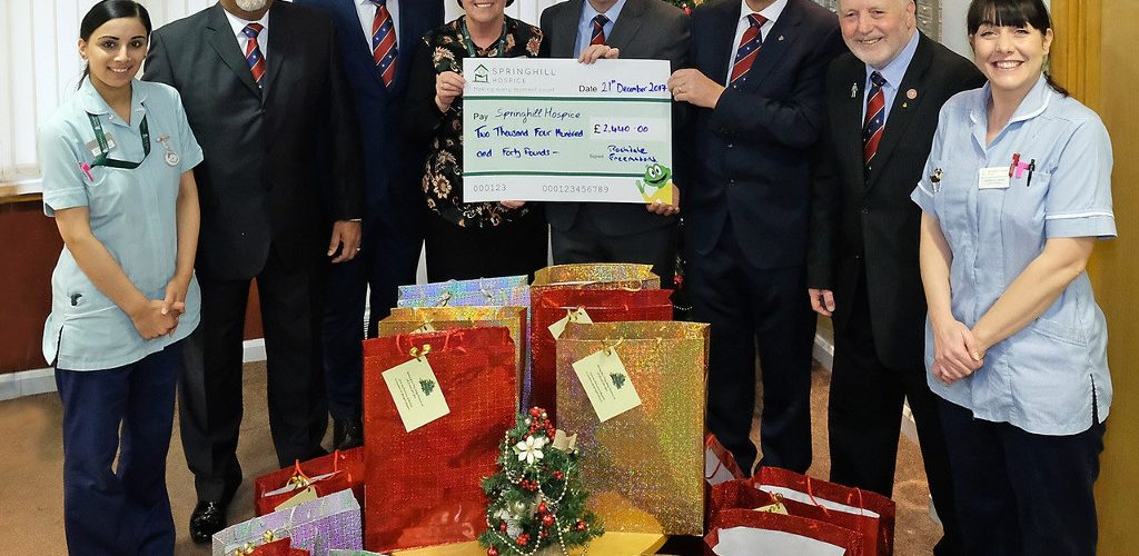 Springhill Hospice receive a cheque from the Freemasons Grand Charity